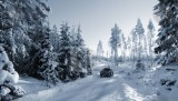 cutcaster-photo-801019958-suv-car-driving-in-snowy-winter