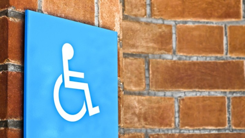 wall-with-wheelchair-sign