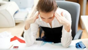 stressed-woman-sitting-at-office-desk