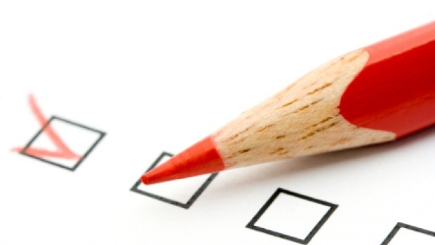 Red pencil and questionnaire